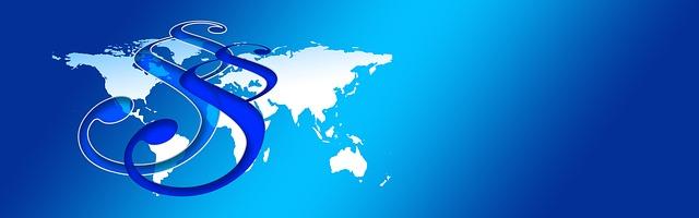 Foto Recht weltweit (© pixabay): Zeigt eine Weltkarte mit darüber liegenden Paragraphen.
